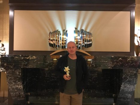 Alexei Krasovsky with his Best Director award from PIFF